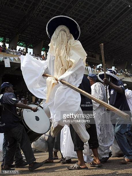 Eyo masquerades dance during the celebration of Eyo festival in Lagos on November 26 2011 The Adamu Orisa play otherwise known as Eyo festival a...