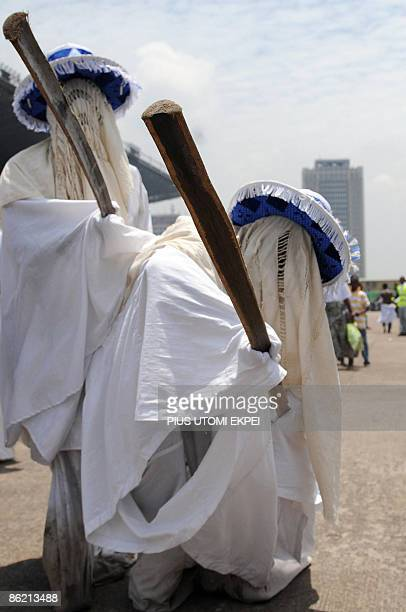 Eyo masquerades known as AdamuOrisha dance at the Tafawa Balewa Square in Lagos on April 25 2009 The Eyo festival dating back to 1750 and takes place...