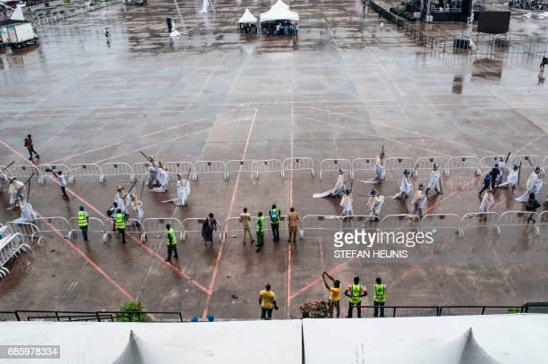 Eyo masquerades walk through as they arrive at the Tafawa Balewa Square in Lagos on May 20 2017 The whiteclad Eyo masquerades represent the spirits...