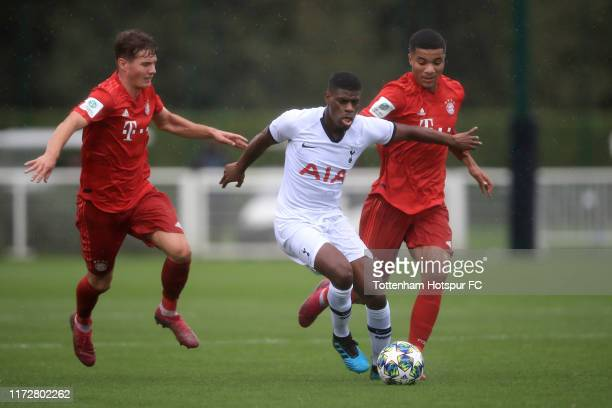 Eyoma of Tottenham Hotspur in action with Malik Tillman and Jahn Herrmann of Bayern Munich during the UEFA Youth League Group B match between...