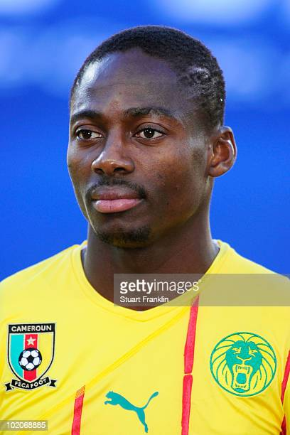 Eyong Enoh of Cameroon lines up for the national anthems prior to the 2010 FIFA World Cup South Africa Group E match between Japan and Cameroon at...