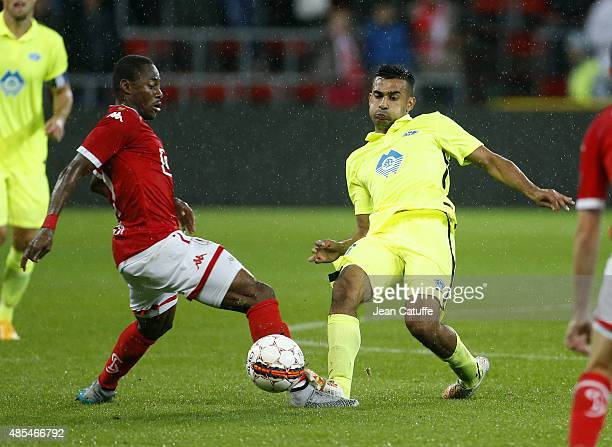 Eyong Enoh of Standard de Liege and Etzaz Hussain of Molde FK and Anthony Knockaert of Standard de Liege in action during the UEFA Europa League play...