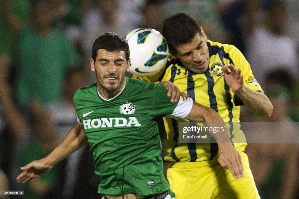 Eytan Tibi (R) of Maccabi Tel-Aviv FC challenges Shlomi Azulay of Maccabi Haifa FC during the Israeli Premier League match between Maccabi Haifa FC and Maccabi Tel-Aviv FC held on April 29, 2013 at the Kiryat Eliezer Stadium in Haifa, Israel.