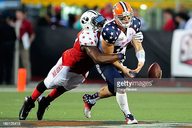 Ezekial Ansah of the South squad forces a fumble by Ryan Nassib of the North squad during the Senior Bowl at Ladd Peebles Stadium on January 26 2013...