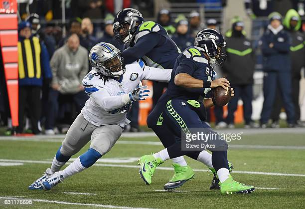 Ezekiel Ansah of the Detroit Lions attempts to tackle Russell Wilson of the Seattle Seahawks during the first half of the NFC Wild Card game at...