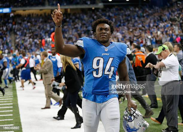 Ezekiel Ansah of the Detroit Lions celebrates a 3130 victory over the Dallas Cowboys at Ford Field on October 27 2013 in Detroit Michigan