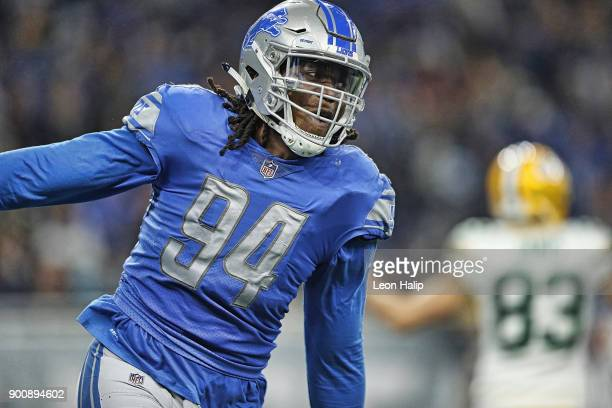 Ezekiel Ansah of the Detroit Lions celebrates after a sack in the fourth quarter of the game against the Green Bay Packers at Ford Field on December...
