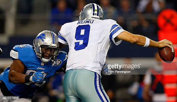 Ezekiel Ansah of the Detroit Lions closes in on Tony Romo during the second half of their NFC Wild Card Playoff game at ATT Stadium on January 4 2015...