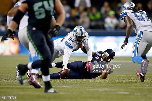 Ezekiel Ansah of the Detroit Lions forces and recovers a fumble by Russell Wilson of the Seattle Seahawks during the second half of their game at...