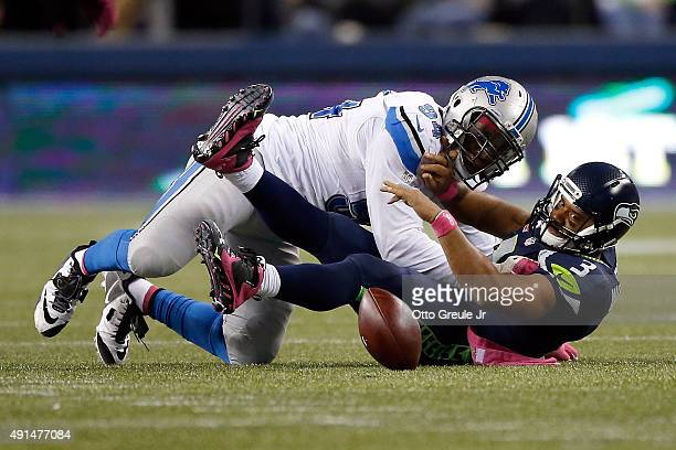 Ezekiel Ansah of the Detroit Lions forces and recovers a fumble by Russell Wilson of the Seattle Seahawks during the fourth quarter of their game at...