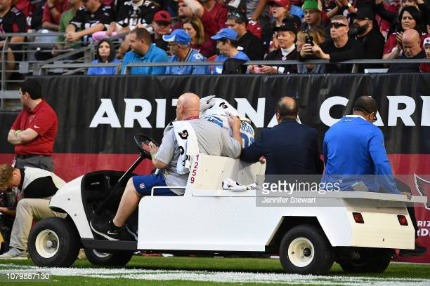 Ezekiel Ansah of the Detroit Lions is carted off the field after an injury during the NFL game against the Arizona Cardinals at State Farm Stadium on...