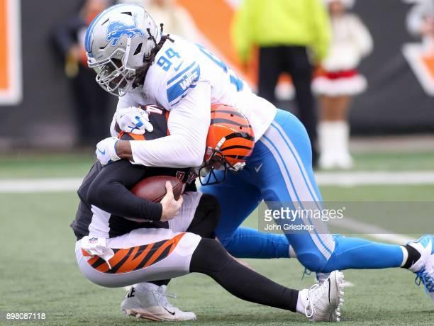 Ezekiel Ansah of the Detroit Lions sacks Andy Dalton of the Cincinnati Bengals during the first half at Paul Brown Stadium on December 24 2017 in...