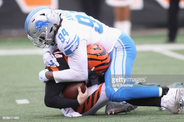 Ezekiel Ansah of the Detroit Lions sacks Andy Dalton of the Cincinnati Bengals during their game at Paul Brown Stadium on December 24 2017 in...