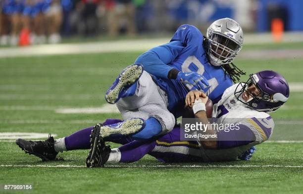Ezekiel Ansah of the Detroit Lions sacks quarterback Case Keenum of the Minnesota Vikings during the second half at Ford Field on November 23 2016 in...