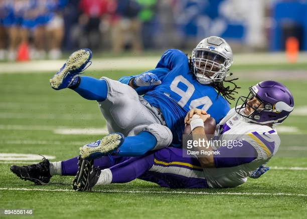 Ezekiel Ansah of the Detroit Lions sacks quarterback Case Keenum of the Minnesota Vikings during the second half during an NFL game at Ford Field on...