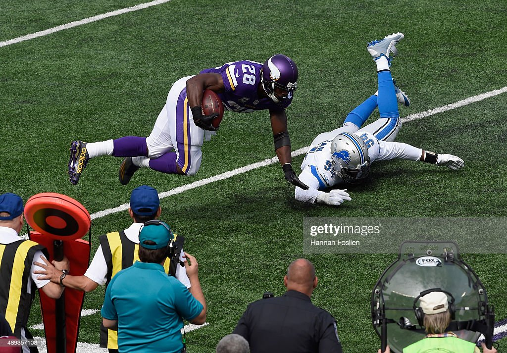 Ezekiel Ansah #94 of the Detroit Lions tackles Adrian Peterson #28 of the Minnesota Vikings during the first quarter of the game on September 20, 2015 at TCF Bank Stadium in Minneapolis, Minnesota. The Vikings defeated the Lions 26-16.