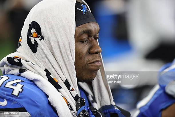 Ezekiel Ansah of the Detroit Lions watches the final seconds of the clock run down during the game against the Green Bay Packers at Ford Field on...