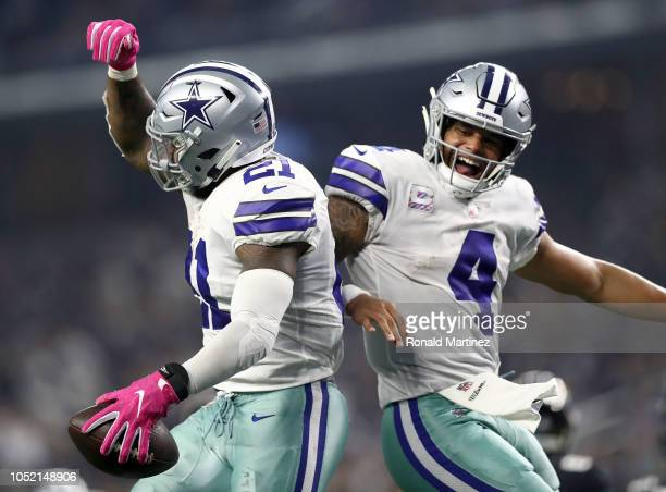 Ezekiel Elliott and Dak Prescott of the Dallas Cowboys celebrate the fourth quarter touchdown against the Jacksonville Jaguars at AT&T Stadium on...