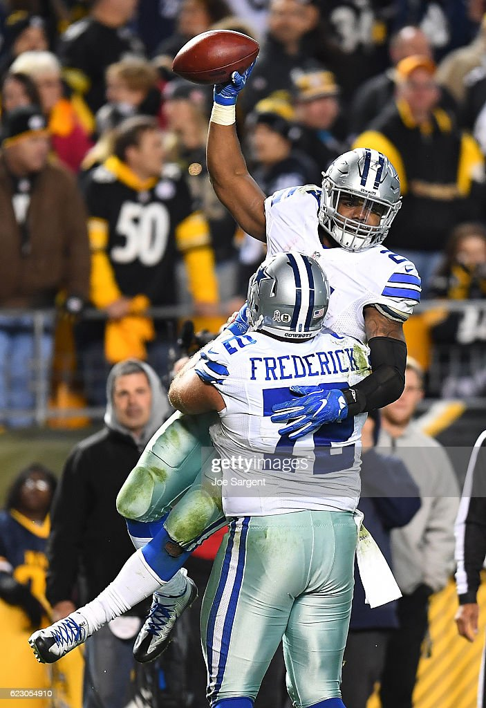 Ezekiel Elliott #21 is hugged by Travis Frederick #72 of the Dallas Cowboys after rushing for a 32 yard touchdown in the fourth quarter during the game against the Pittsburgh Steelers at Heinz Field on November 13, 2016 in Pittsburgh, Pennsylvania.