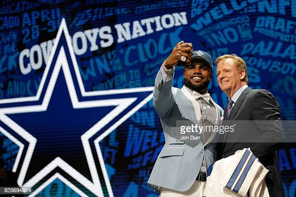Ezekiel Elliott of Ohio State poses with NFL Commissioner Roger Goodell after being picked overall by the Dallas Cowboys during the first round of...