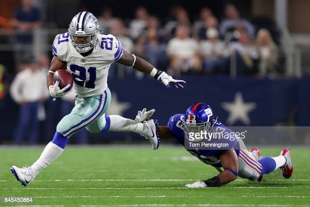 Ezekiel Elliott of the Dallas Cowboys carries the ball against BJ Goodson of the New York Giants in the second half at ATT Stadium on September 10...