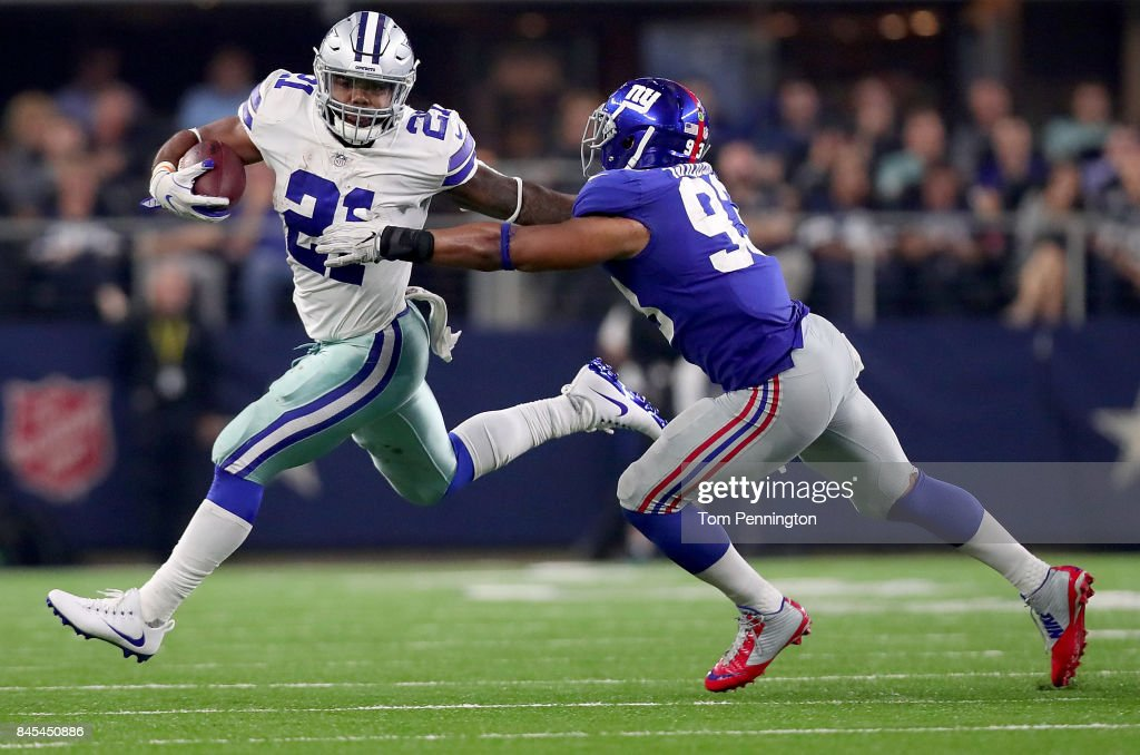 Ezekiel Elliott #21 of the Dallas Cowboys carries the ball against B.J. Goodson #93 of the New York Giants in the second half at AT&T Stadium on September 10, 2017 in Arlington, Texas.