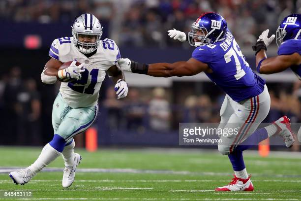 Ezekiel Elliott of the Dallas Cowboys carries the ball against BJ Goodson of the New York Giants and Romeo Okwara of the New York Giants in the...