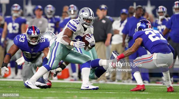 Ezekiel Elliott of the Dallas Cowboys carries the ball against BJ Goodson of the New York Giants and Darian Thompson of the New York Giants in the...