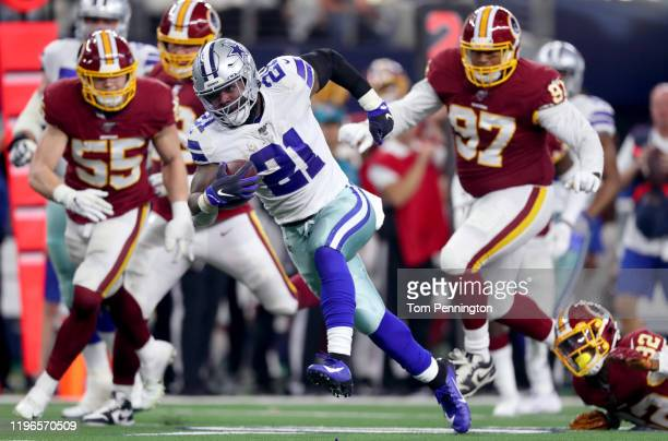 Ezekiel Elliott of the Dallas Cowboys carries the ball against the Washington Redskins in the second quarter at ATT Stadium on December 29 2019 in...