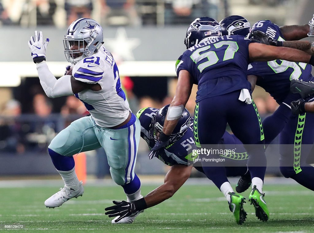 Ezekiel Elliott #21 of the Dallas Cowboys carries the ball against the Seattle Seahawks in the second quarter at AT&T Stadium on December 24, 2017 in Arlington, Texas.