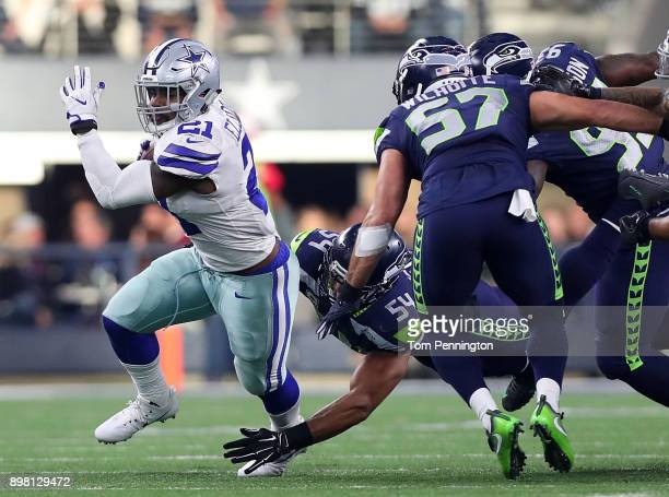 Ezekiel Elliott of the Dallas Cowboys carries the ball against the Seattle Seahawks in the second quarter at ATT Stadium on December 24 2017 in...