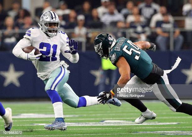Ezekiel Elliott of the Dallas Cowboys carries the ball as Kamu GrugierHill of the Philadelphia Eagles pursues in the first quarter at ATT Stadium on...