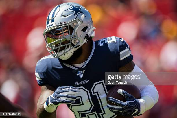 Ezekiel Elliott of the Dallas Cowboys carries the ball before the game against the Washington Redskins at FedExField on September 15 2019 in Landover...