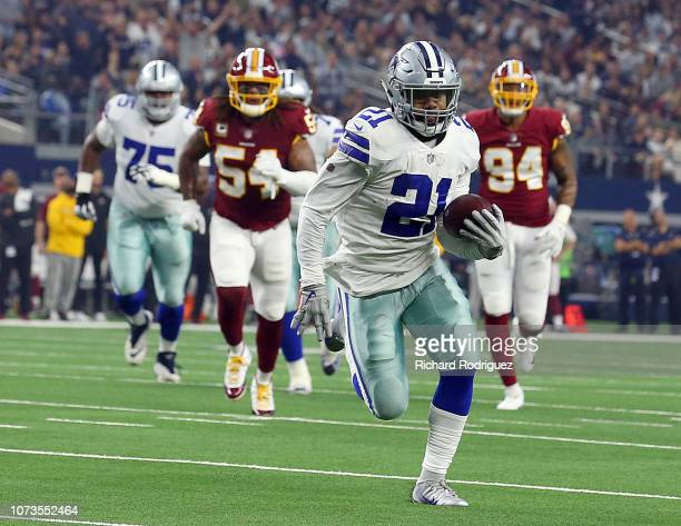 Ezekiel Elliott of the Dallas Cowboys carries the ball for a first quarter touchdown against the Washington Redskins at ATT Stadium on November 22...
