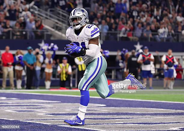 Ezekiel Elliott of the Dallas Cowboys carries the ball into the end zone to score a touchdown during the second quarter against the Tampa Bay...