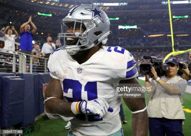 Ezekiel Elliott of the Dallas Cowboys celebrates a fourth quarter touchdown against the New York Giants at ATT Stadium on September 16 2018 in...