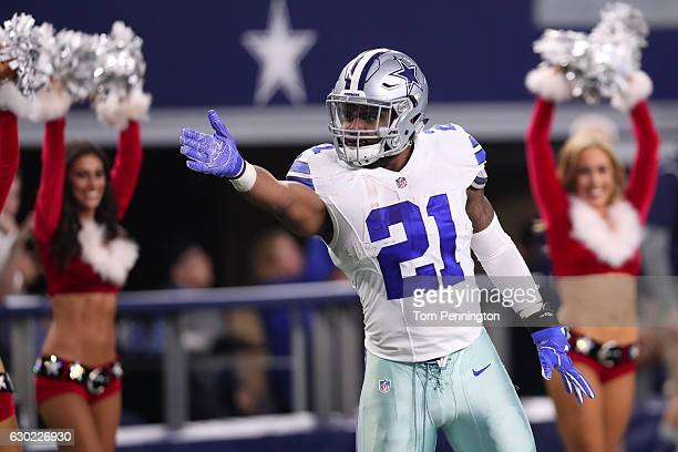 Ezekiel Elliott of the Dallas Cowboys celebrates after rushing for a first down during the fourth quarter against the Tampa Bay Buccaneers at ATT...