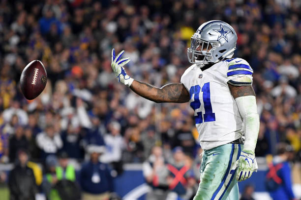 Ezekiel Elliott of the Dallas Cowboys celebrates after scoring a 1 yard touchdown in the third quarter against the Los Angeles Rams in the NFC...
