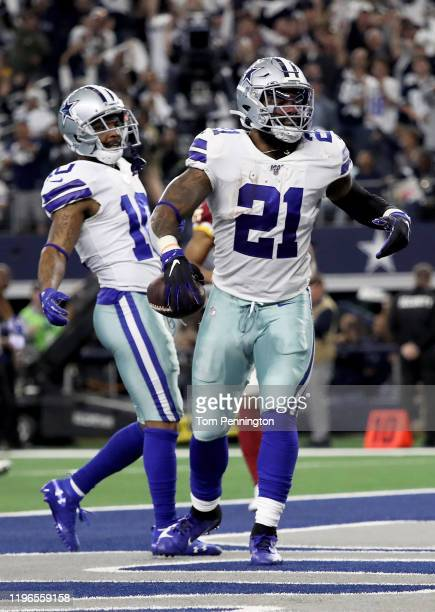 Ezekiel Elliott of the Dallas Cowboys celebrates after scoring a touchdown in the second quarter against the Washington Redskins in the game at ATT...