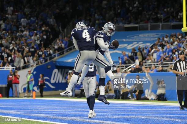 Ezekiel Elliott of the Dallas Cowboys celebrates his fourth quarter touchdown with Dak Prescott of the Dallas Cowboys against the Detroit Lions at...