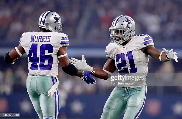 Ezekiel Elliott of the Dallas Cowboys celebrates with Alfred Morris of the Dallas Cowboys after Morris scored against the Chicago Bears in the second...