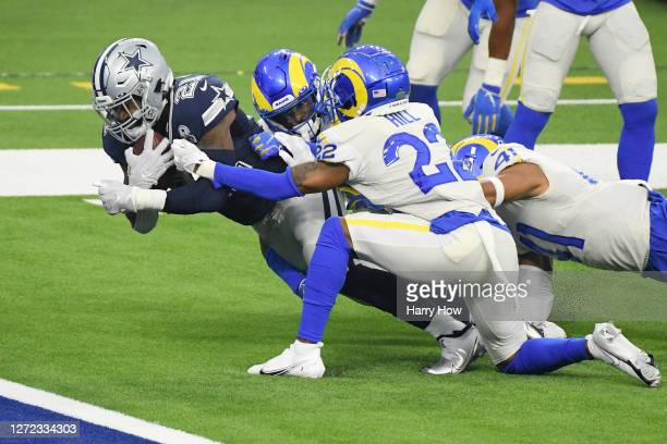 Ezekiel Elliott of the Dallas Cowboys dives for a 19-yard receiving touchdown during the second quarter against the Los Angeles Rams at SoFi Stadium...