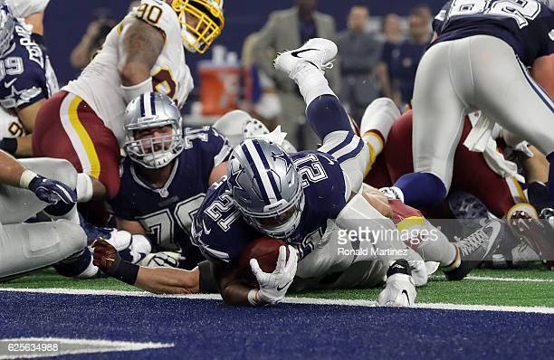 Ezekiel Elliott of the Dallas Cowboys dives into the end zone for a touchdown during the fourth quarter against the Washington Redskins at ATT...