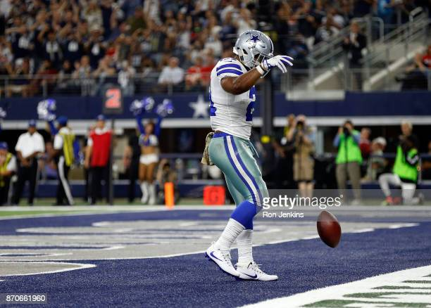 Ezekiel Elliott of the Dallas Cowboys drops the football in the endzone after scoring a touchdown in the third quarter against the Kansas City Chiefs...