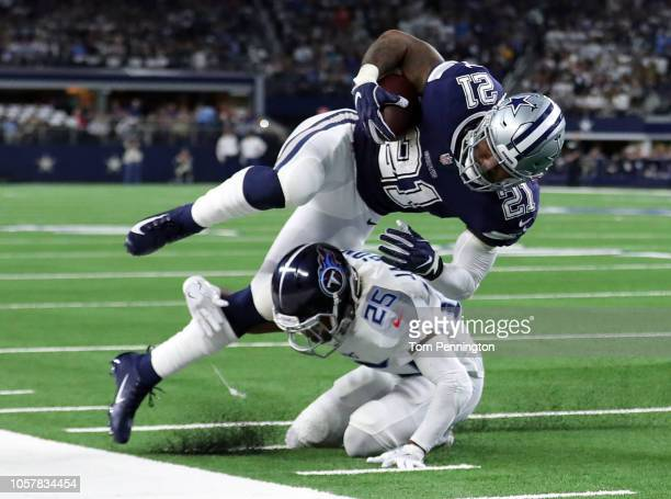 Ezekiel Elliott of the Dallas Cowboys gets knocked out of bounds by Adoree' Jackson of the Tennessee Titans in the first quarter of a game at AT&T...
