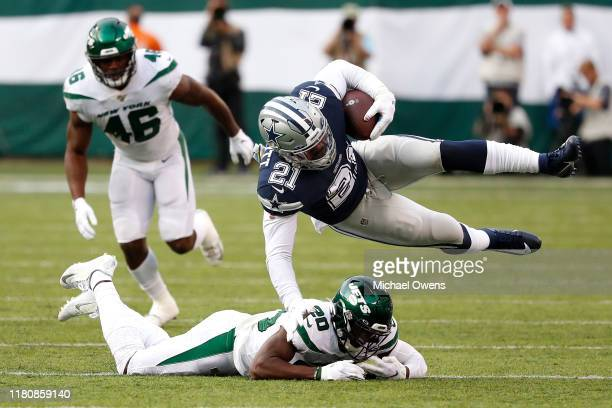 Ezekiel Elliott of the Dallas Cowboys is brought down by Marcus Maye of the New York Jets during the first quarter at MetLife Stadium on October 13...