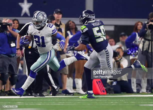 Ezekiel Elliott of the Dallas Cowboys is pursued by of the Seattle Seahawks in the first half during the Wild Card Round at ATT Stadium on January 05...