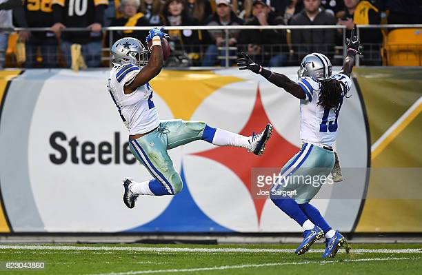 Ezekiel Elliott of the Dallas Cowboys jumps into the end zone for an 83 yard touchdown reception in the first quarter during the game against the...