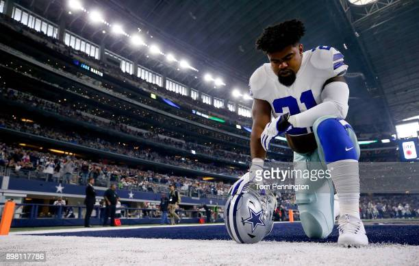 Ezekiel Elliott of the Dallas Cowboys kneels before taking on the Seattle Seahawks at ATT Stadium on December 24 2017 in Arlington Texas