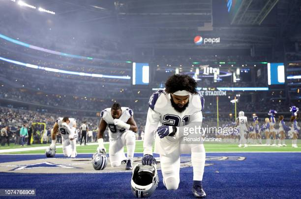 Ezekiel Elliott of the Dallas Cowboys kneels in the endzone before a game against the New Orleans Saints at ATT Stadium on November 29 2018 in...